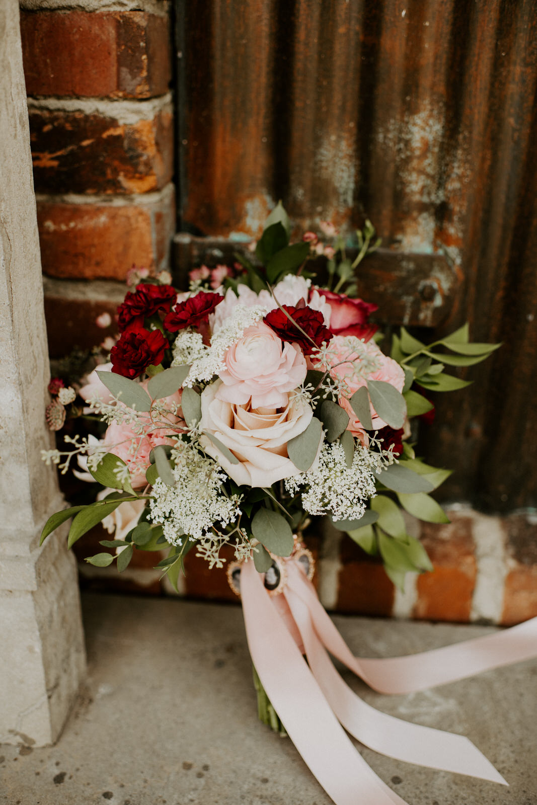 Blush pink and red wedding bouquet: Romantic Nashville Wedding at The Bedford featured on Nashville Bride Guide