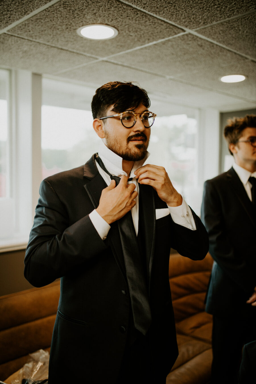 Groom getting ready in wedding attire: Romantic Nashville Wedding at The Bedford featured on Nashville Bride Guide