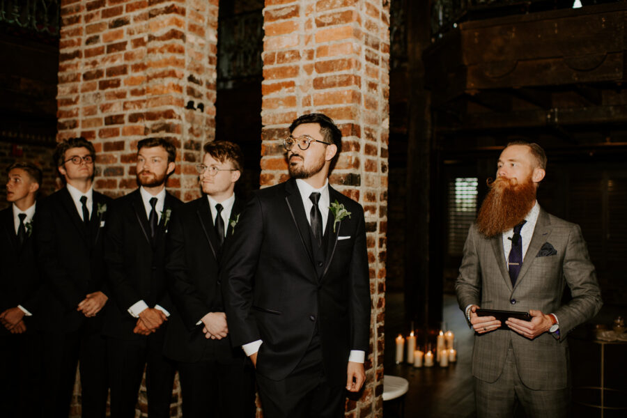 Groom looking at bride coming down the aisle: Romantic Nashville Wedding at The Bedford featured on Nashville Bride Guide