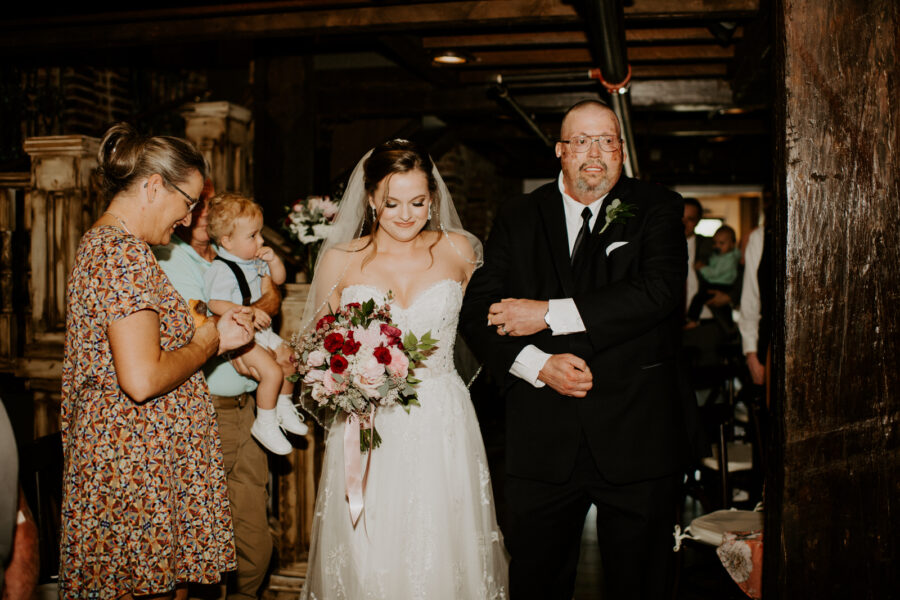 Bride walking down the aisle with father: Romantic Nashville Wedding at The Bedford featured on Nashville Bride Guide