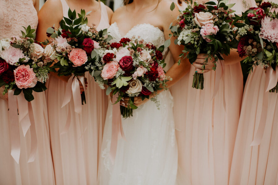 Pink and red wedding bouquets: Romantic Nashville Wedding at The Bedford featured on Nashville Bride Guide