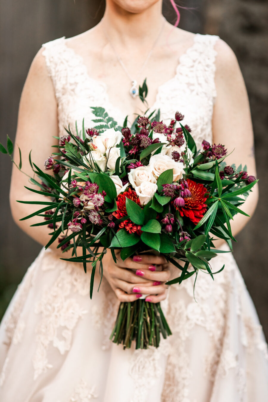 Red and white wintery wedding bouquet: Nashville Wish Upon a Wedding captured by Nyk + Cali Photography featured on Nashville Bride Guide