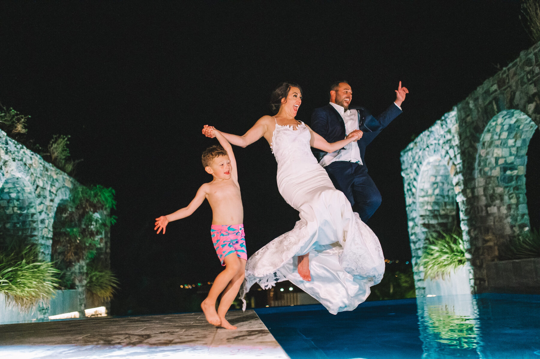 Bride and groom jumping into the pool: Intimate Caribbean Wedding by Details Nashville featured on Nashville Bride Guide