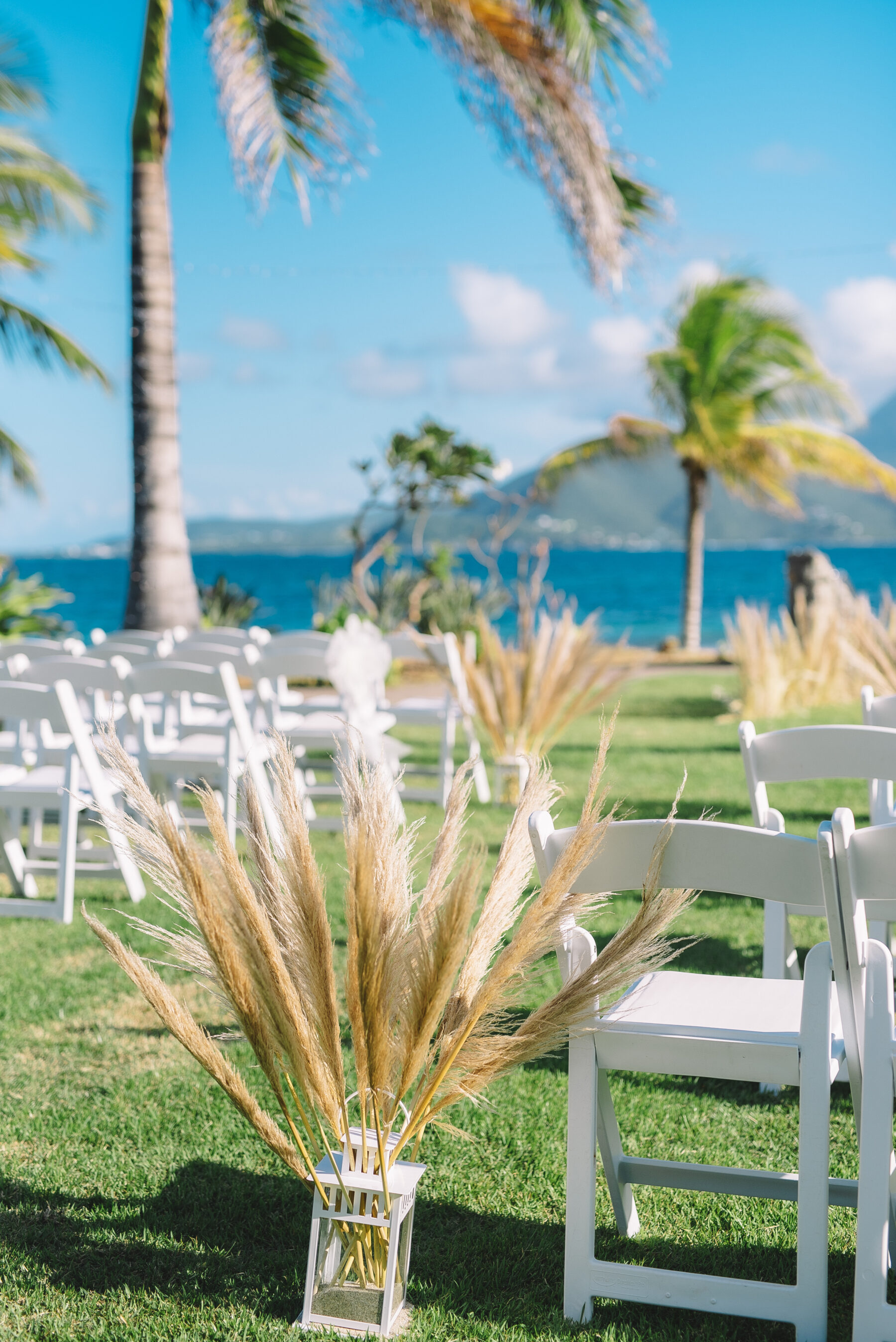 Palm trees wedding ceremony: Intimate Caribbean Wedding by Details Nashville featured on Nashville Bride Guide