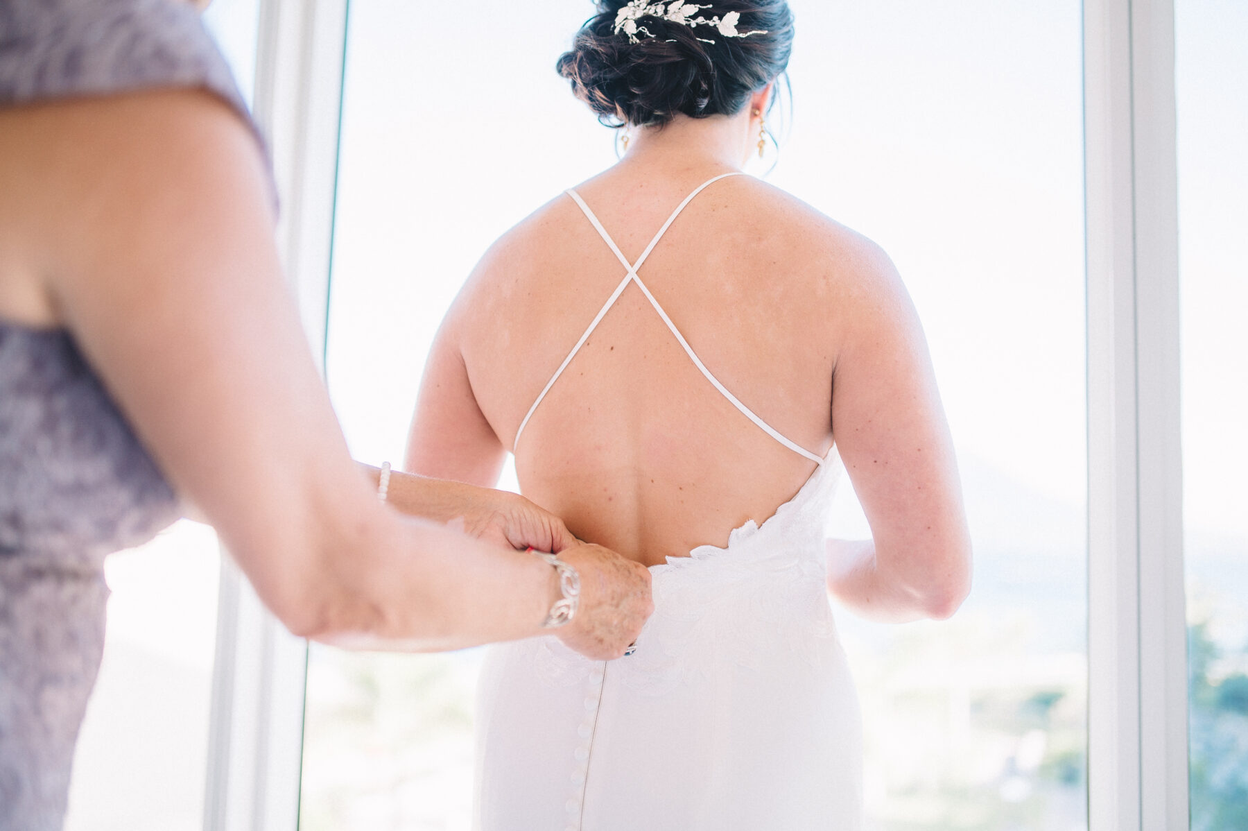 Bride getting ready in wedding dress: Intimate Caribbean Wedding by Details Nashville featured on Nashville Bride Guide