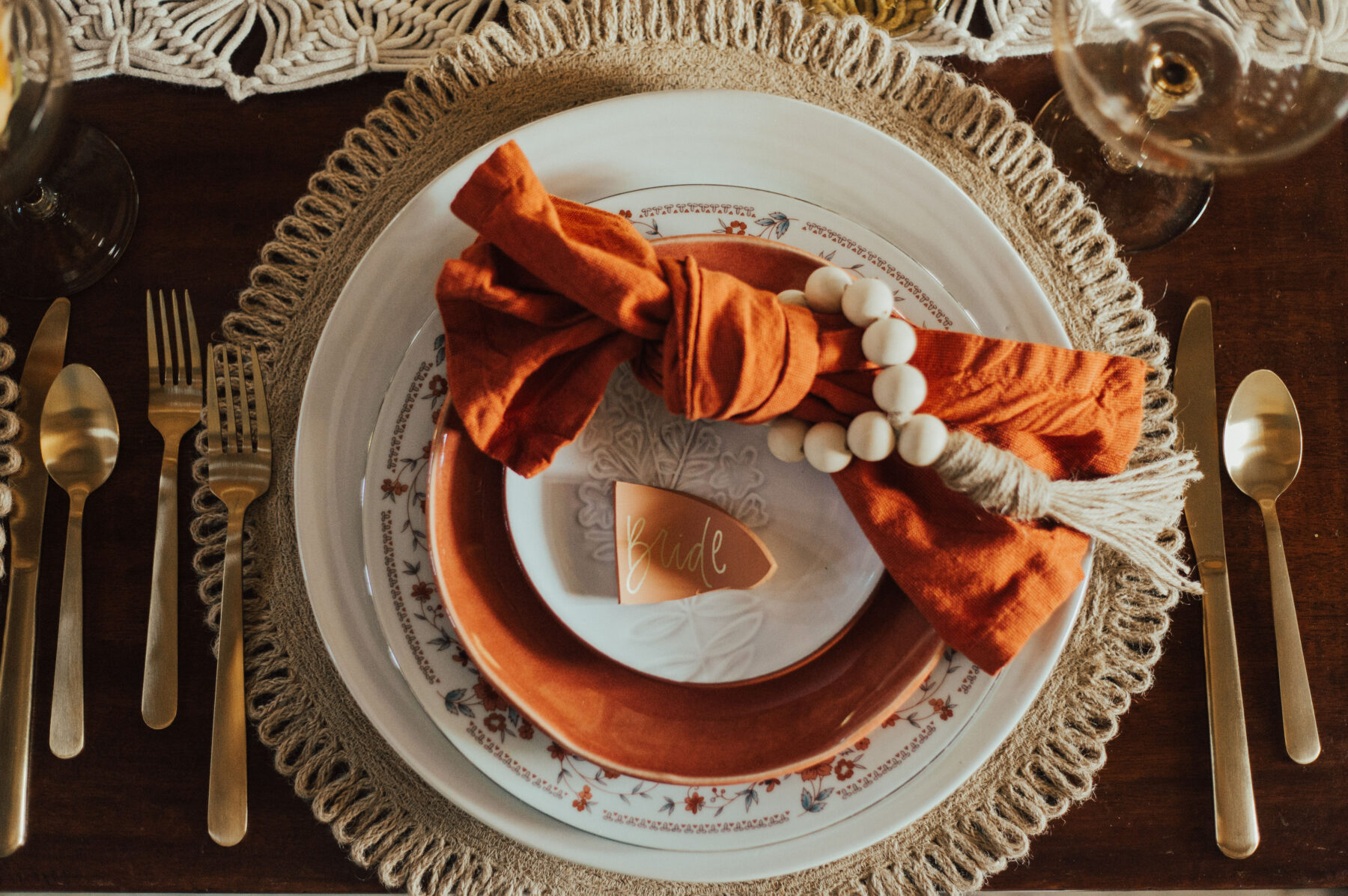 Orange boho wedding place setting: Bright Bohemian Photo Shoot from Ina J Designs