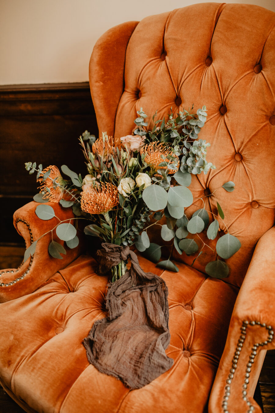 Orange and eucalyptus wedding bouquet: Stunning Fall Styled Shoot at Promise Manor featured on Nashville Bride Guide