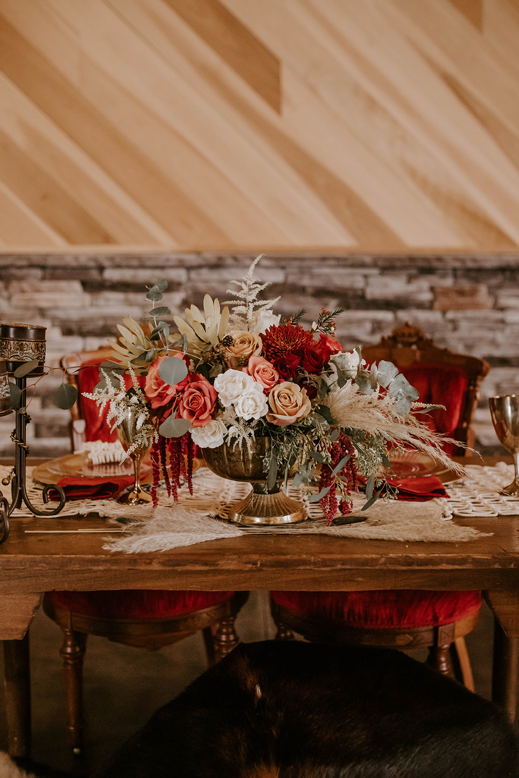 Red boho wedding centerpieces: Surprise Vow Renewal by Tara Winstead Photography