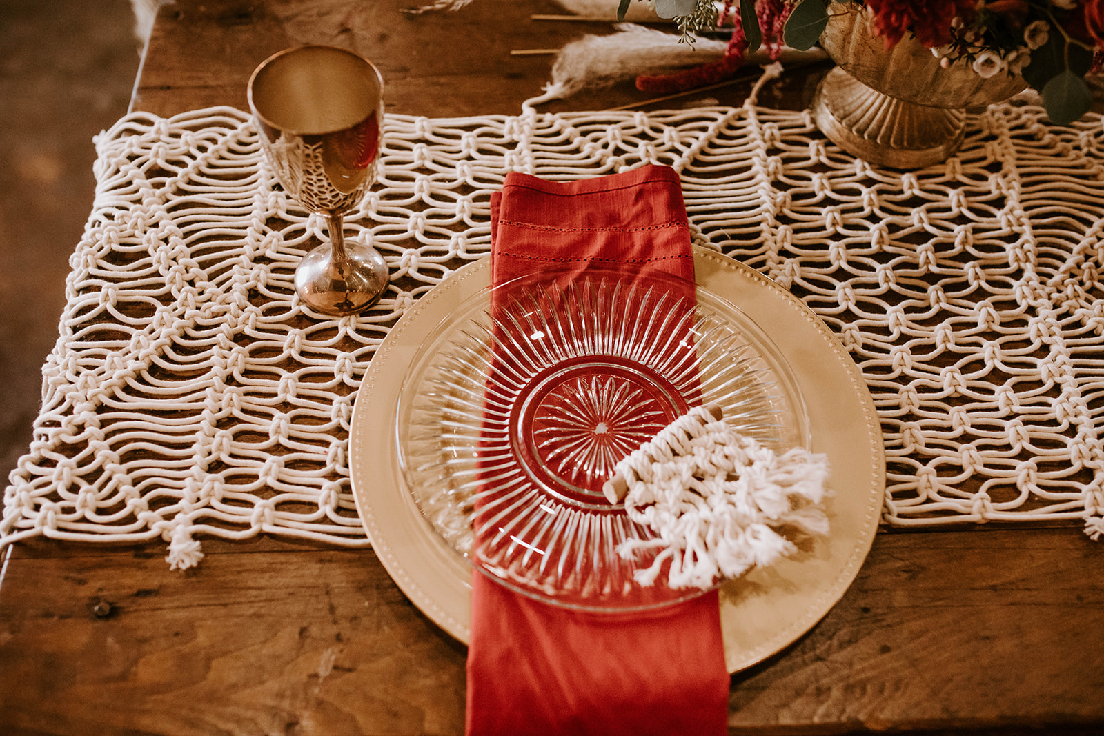 Red and gold wedding place setting: Surprise Vow Renewal by Tara Winstead Photography featured on Nashville Bride Guide