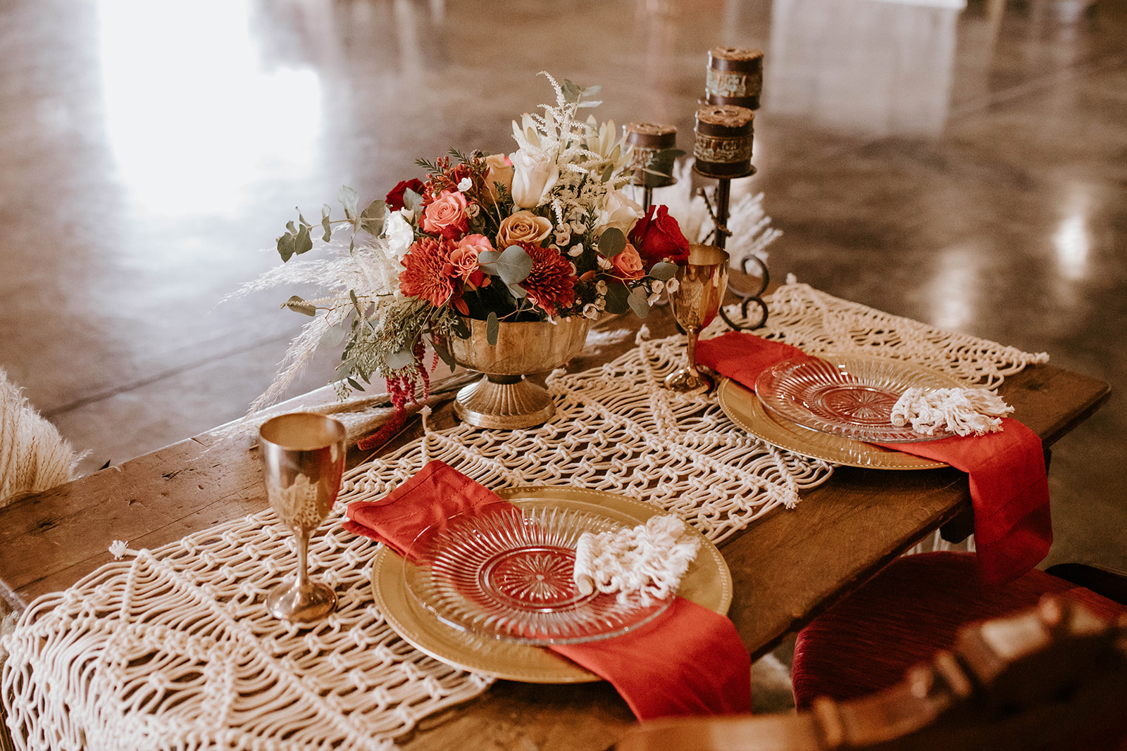 Boho red wedding table decor: Surprise Vow Renewal by Tara Winstead Photography featured on Nashville Bride Guide