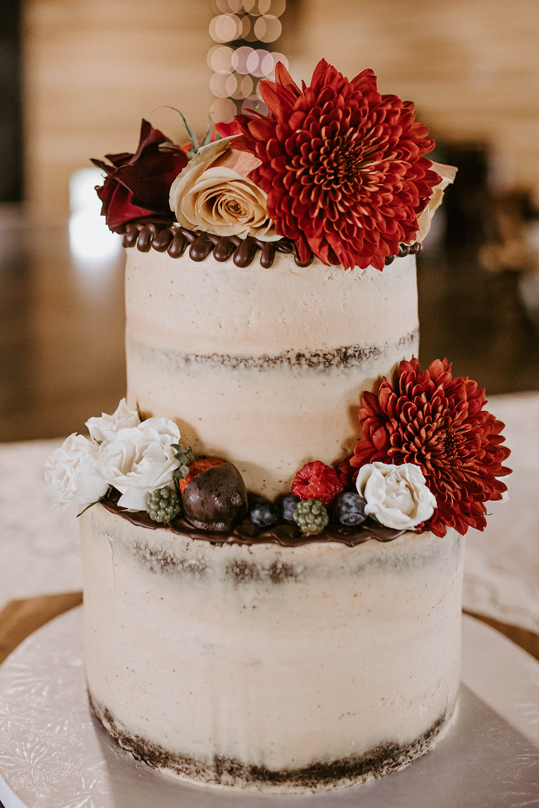 Red floral wedding cake design: Surprise Vow Renewal by Tara Winstead Photography featured on Nashville Bride Guide