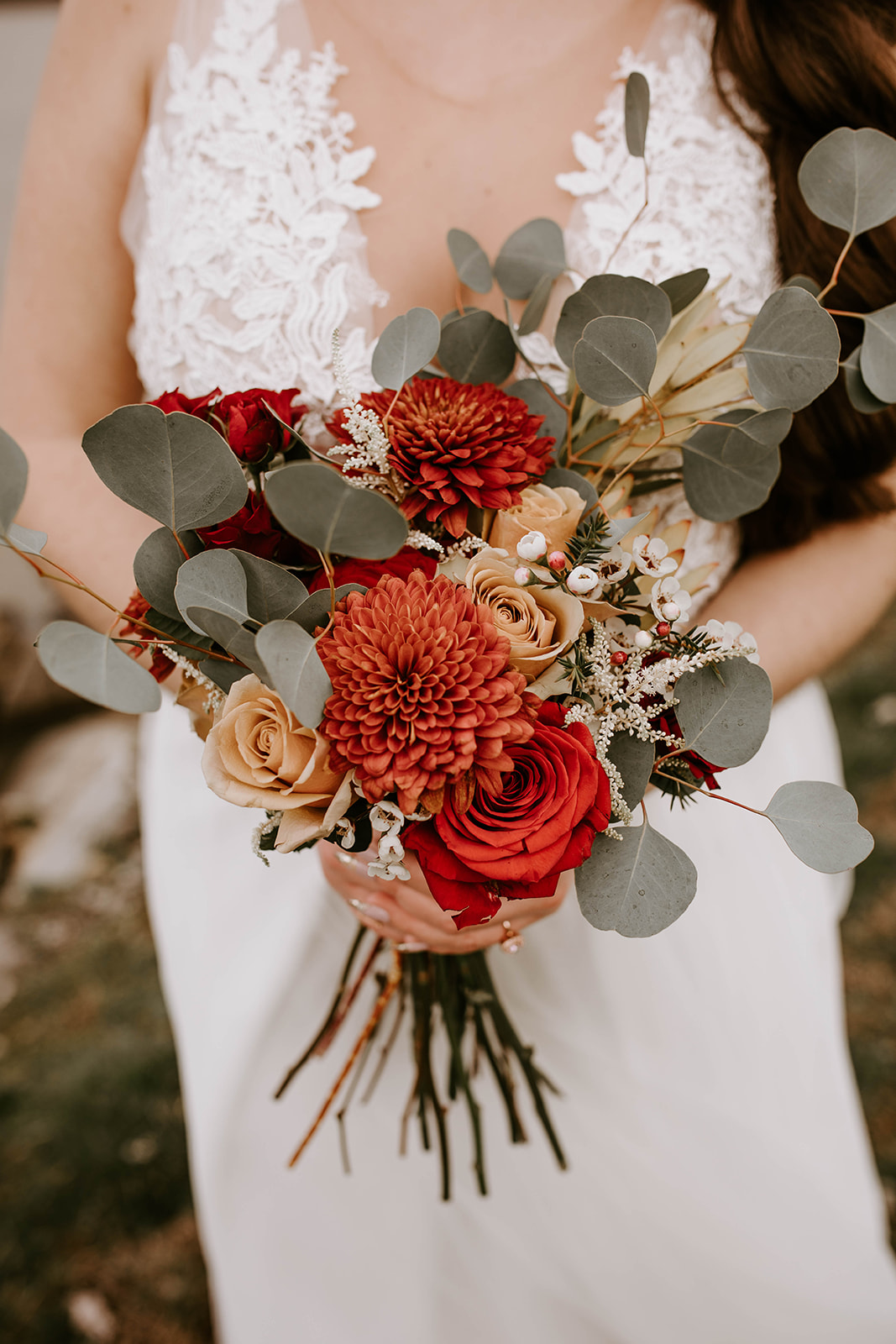 Red wedding bouquet: Surprise Vow Renewal by Tara Winstead Photography featured on Nashville Bride Guide