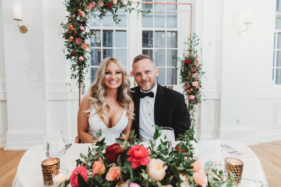 Coral and red floral wedding sweetheart table: Summer Tennessee Wedding at Noelle from Jayde J. Smith Events featured on Nashville Bride Guide