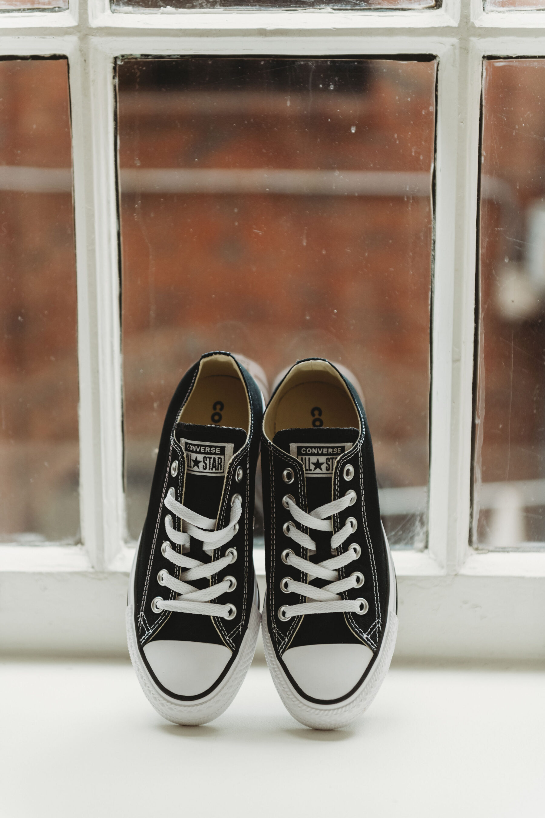 Black converse weddings shoes: Summer Tennessee Wedding at Noelle from Jayde J. Smith Events featured on Nashville Bride Guide