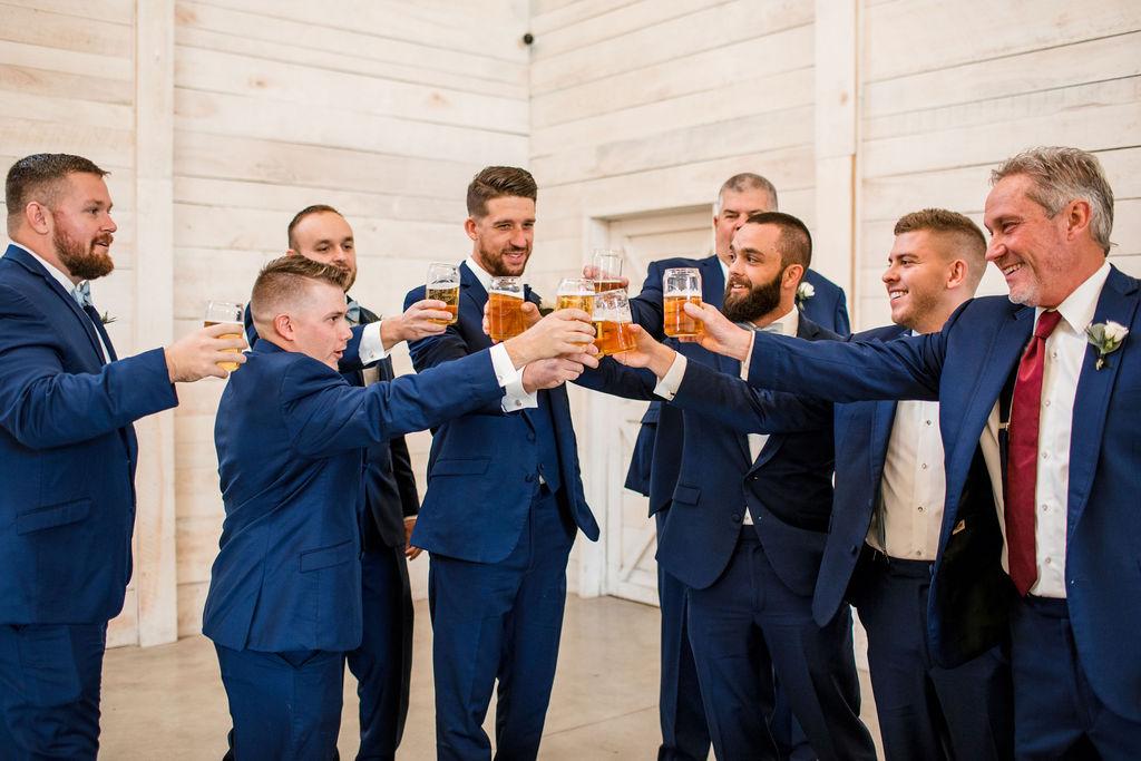Groomsmen celebratory cheers: Intimate Barn Wedding from John Myers Photography
