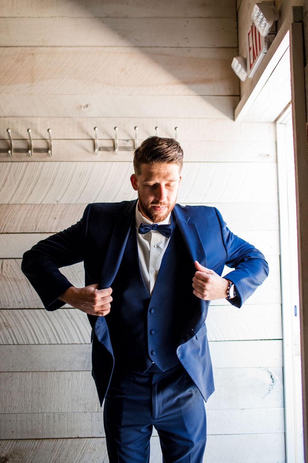 Navy blue groomsmen tuxedo: Intimate Barn Wedding from John Myers Photography