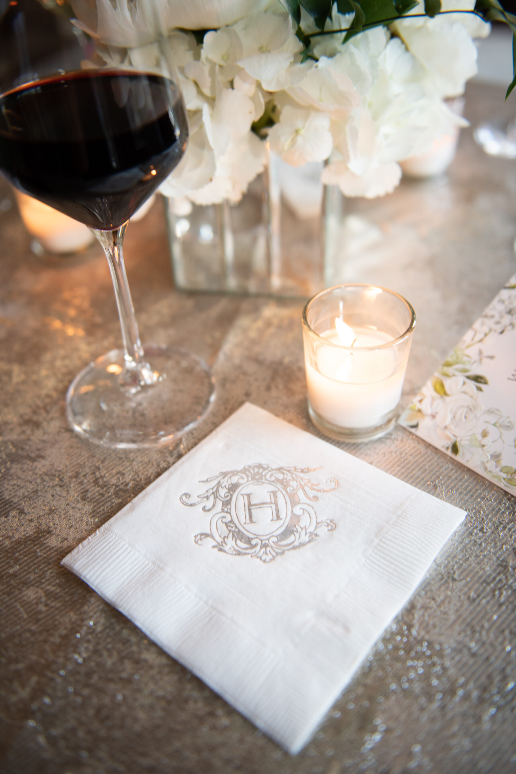 Custom cocktail hour napkins: Floral Filled Luxurious Wedding by LMA Designs featured on Nashville Bride Guide