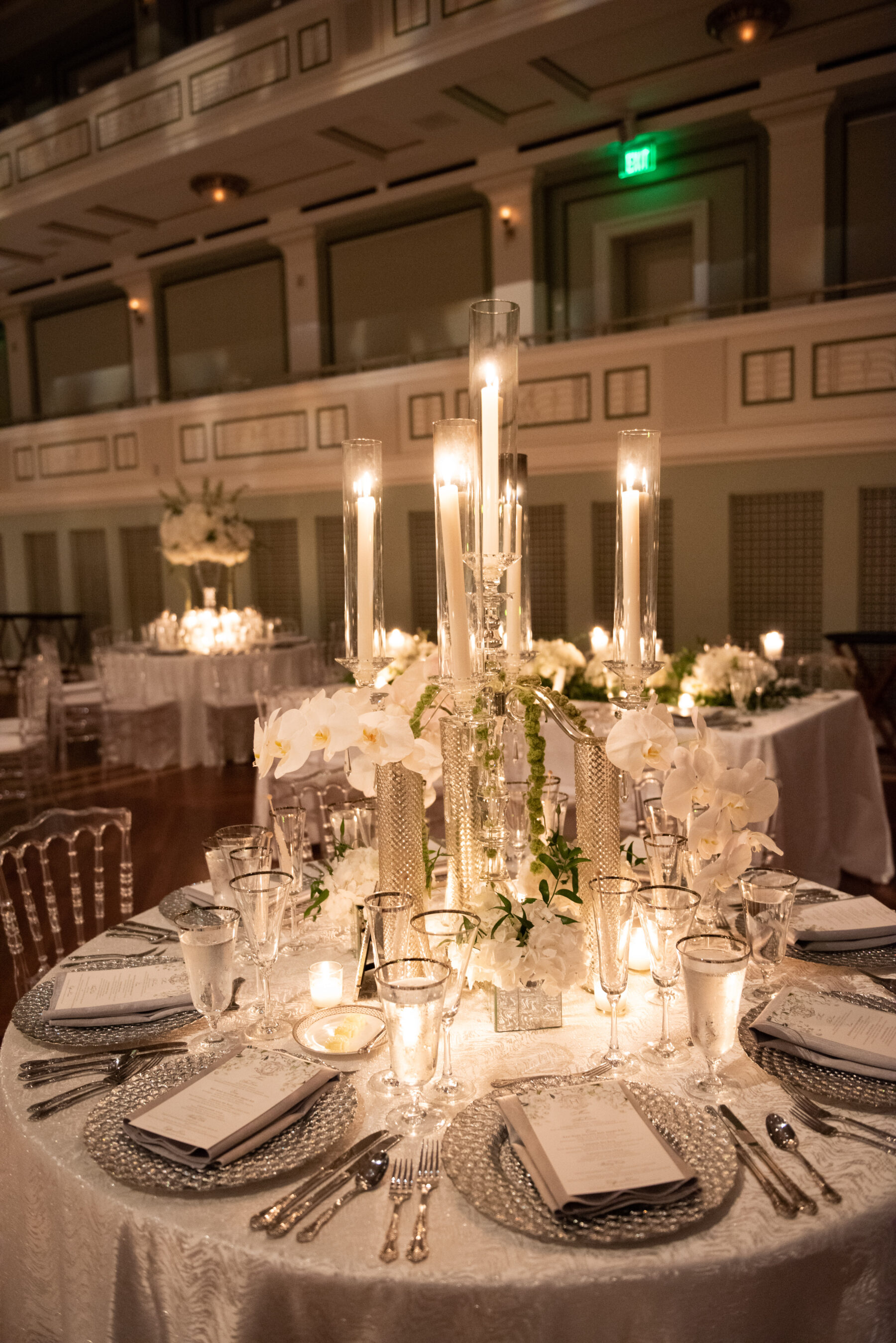 Elevated candlelight wedding centerpieces: Floral Filled Luxurious Wedding by LMA Designs featured on Nashville Bride Guide