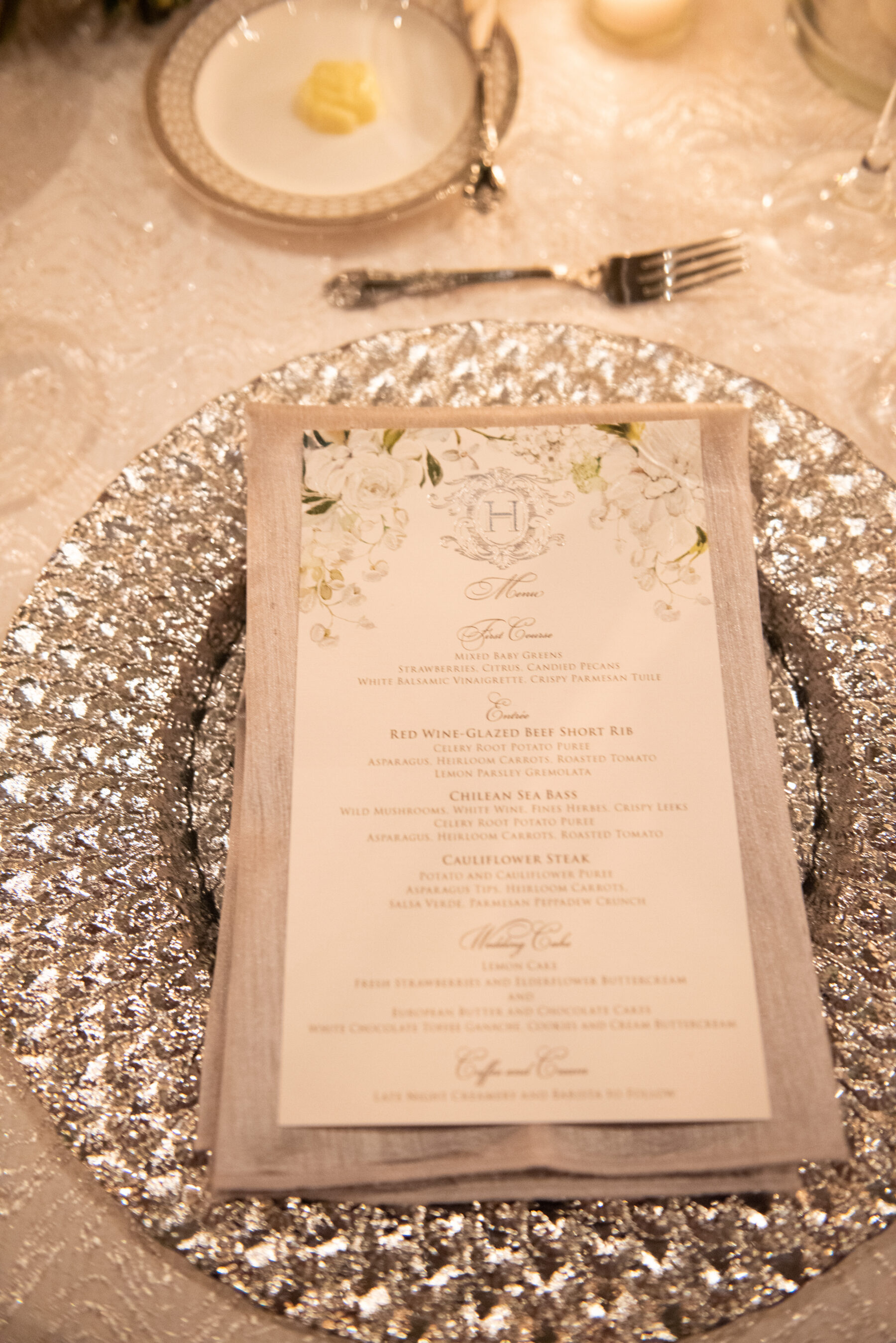 Silver wedding charger: Floral Filled Luxurious Wedding by LMA Designs featured on Nashville Bride Guide