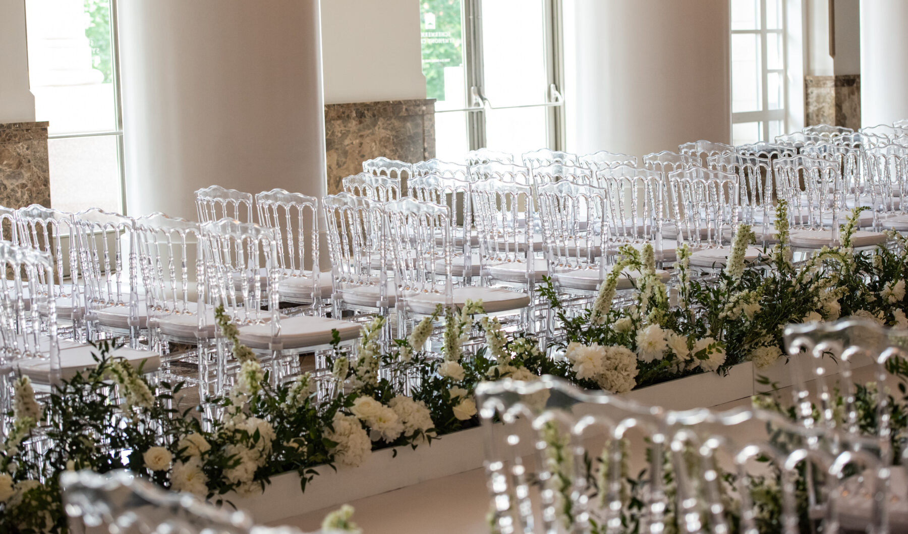 Clear chiavari wedding ceremony chairs: Floral Filled Luxurious Wedding by LMA Designs featured on Nashville Bride Guide