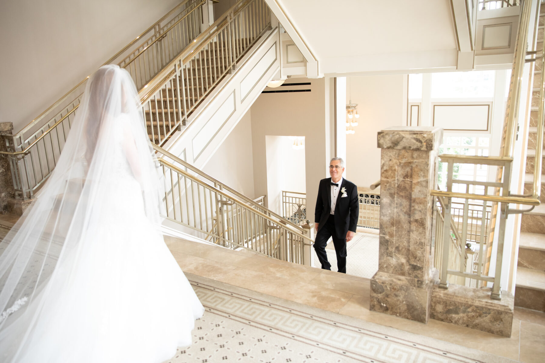 Father daughter first look: Floral Filled Luxurious Wedding by LMA Designs featured on Nashville Bride Guide