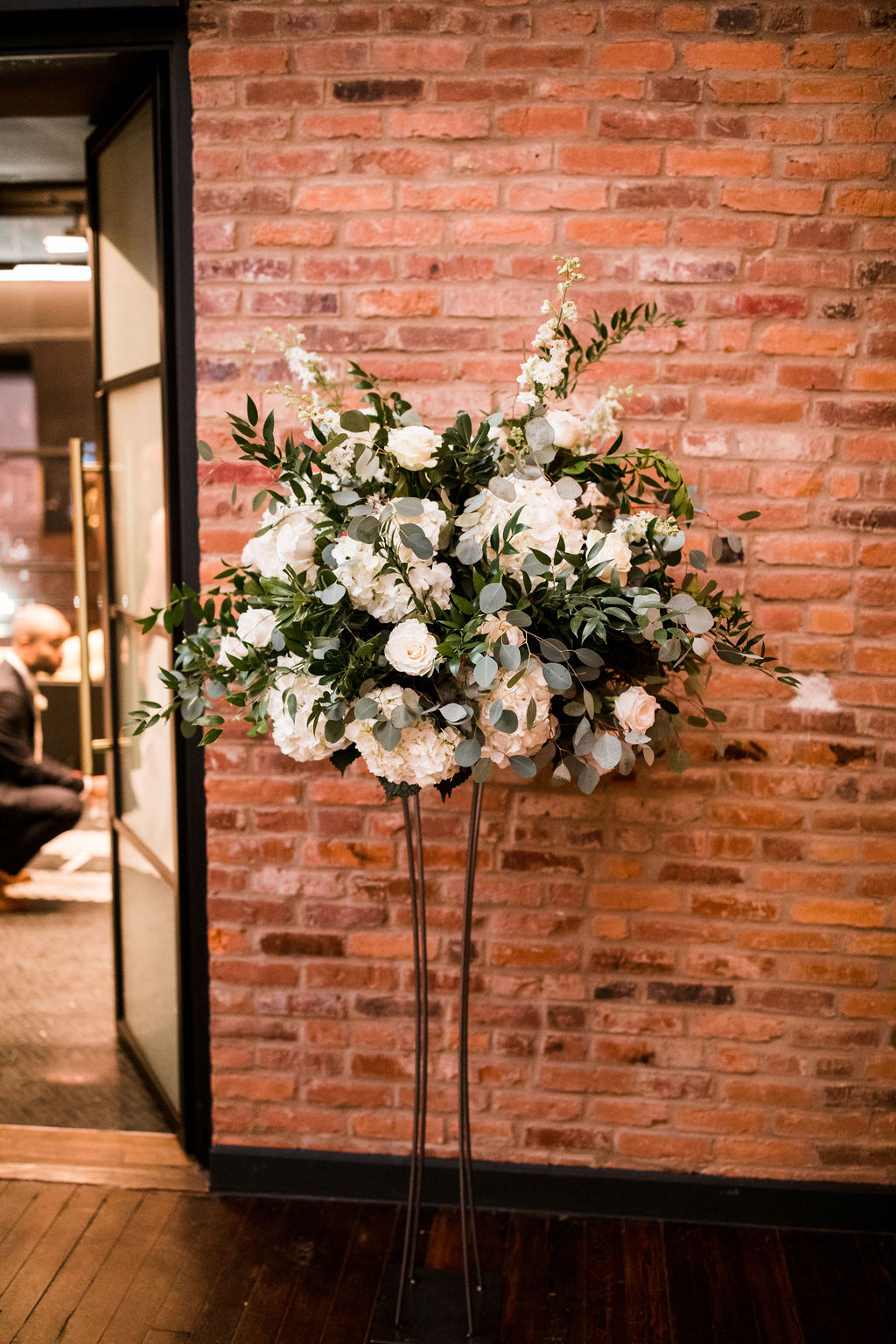 Tall greenery and white wedding centerpieces: Burgundy and Navy Wedding at Clementine Hall