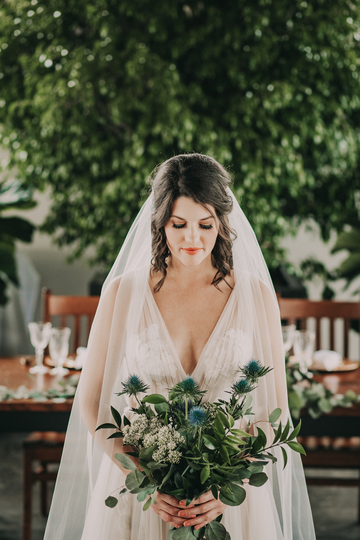 Blue thistle wedding bouquet: Shades of Green Legacy Styled Shoot by Music City Events and Billie-Shaye Style featured on Nashville Bride Guide