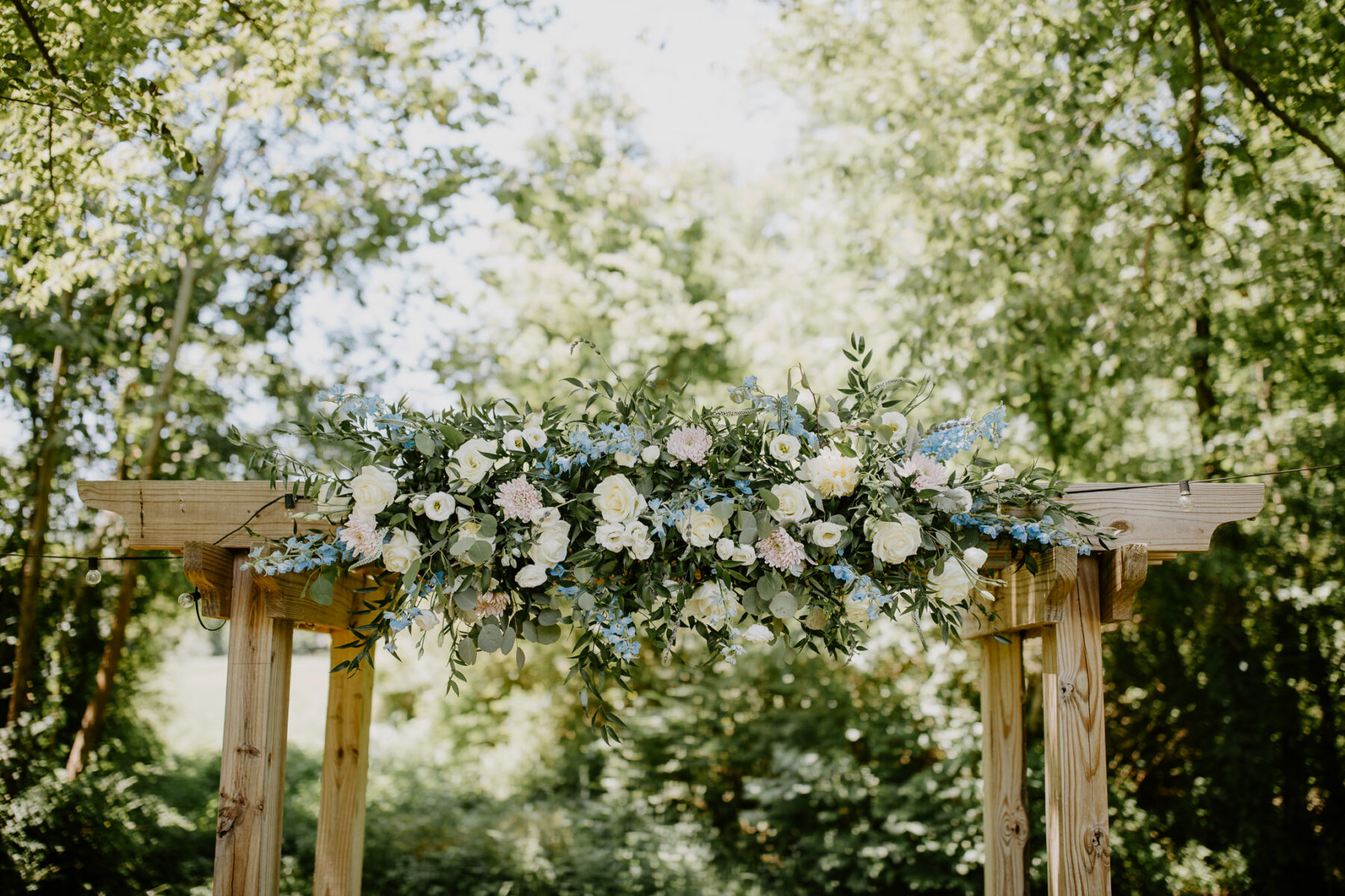 Wedding ceremony flowers: Vibrant Summer Wedding at Sinking Creek Farm featured on Nashville Bride Guide