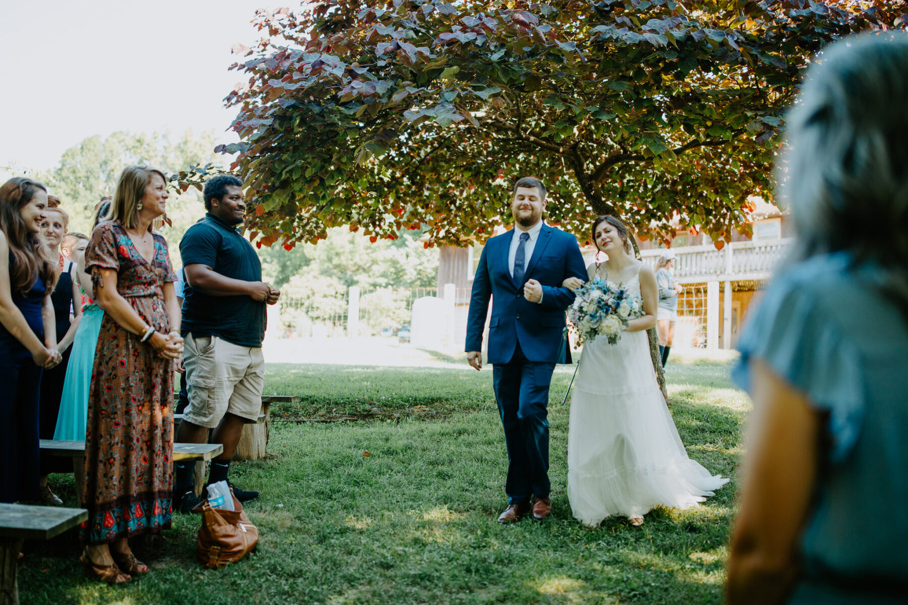 Outdoor wedding: Vibrant Summer Wedding at Sinking Creek Farm featured on Nashville Bride Guide