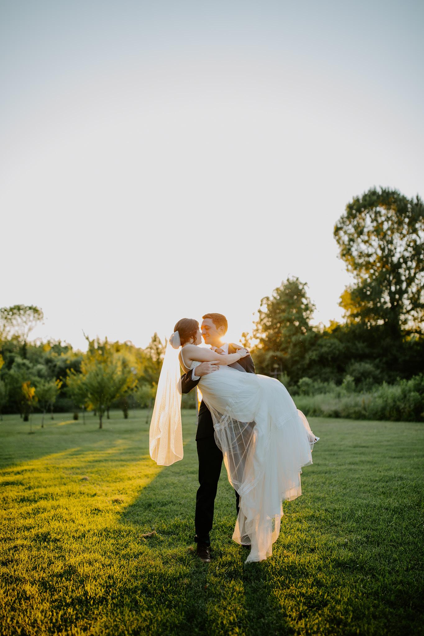 Golden hour wedding photos: Vibrant Summer Wedding at Sinking Creek Farm featured on Nashville Bride Guide
