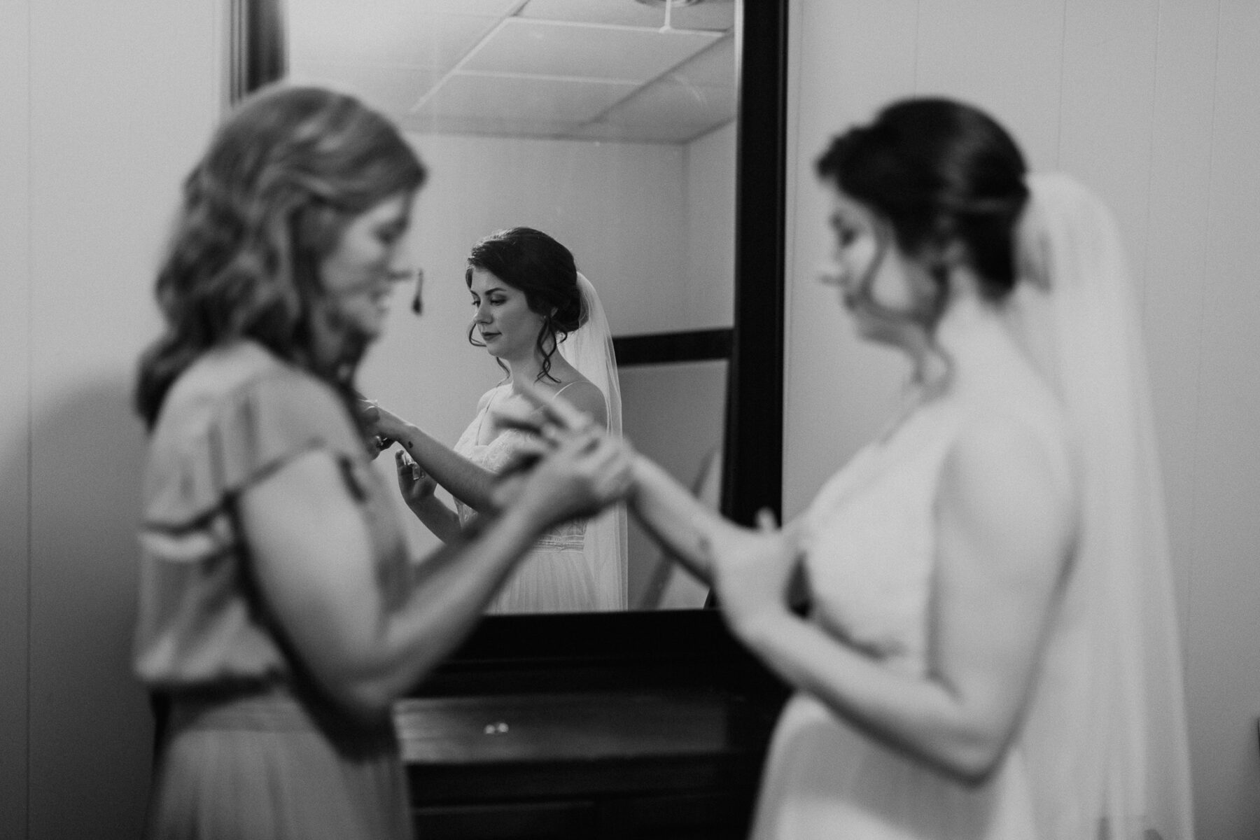 Bride getting ready: Vibrant Summer Wedding at Sinking Creek Farm featured on Nashville Bride Guide