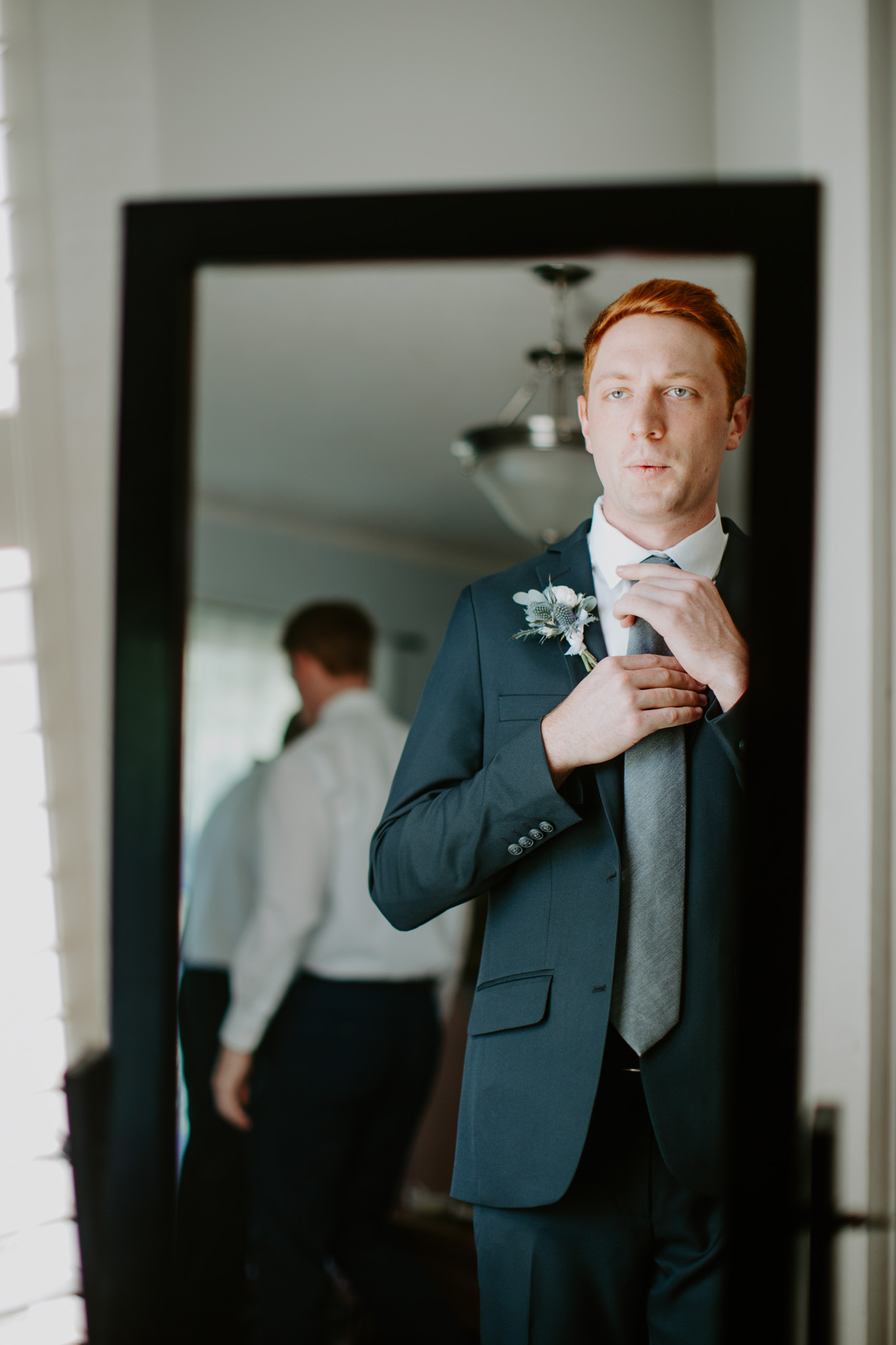 Groom getting ready: Vibrant Summer Wedding at Sinking Creek Farm featured on Nashville Bride Guide