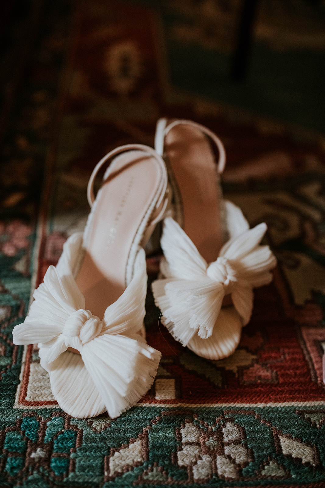 White bow-tie bridal shoes: Timeless Loveless Barn Winter Wedding by Kendall Parsons featured on Nashville Bride Guide