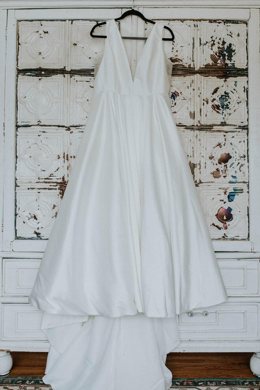 Hanging satin wedding dress with a v-neckline