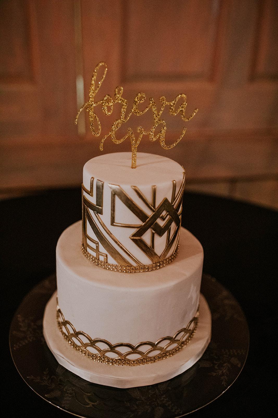 White and gold art deco wedding cake