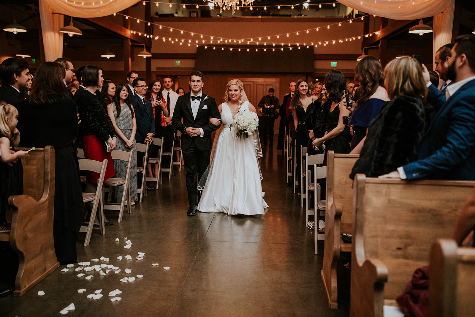 Bride being escorted down the aisle for winter wedding