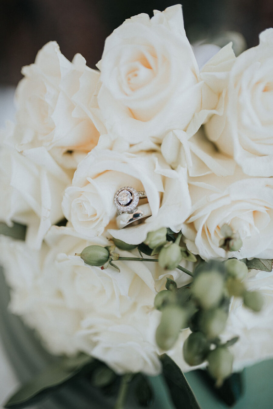 Wedding ring sitting in white wedding bouquet: Romantic Outdoor Wedding at Reunion Stay