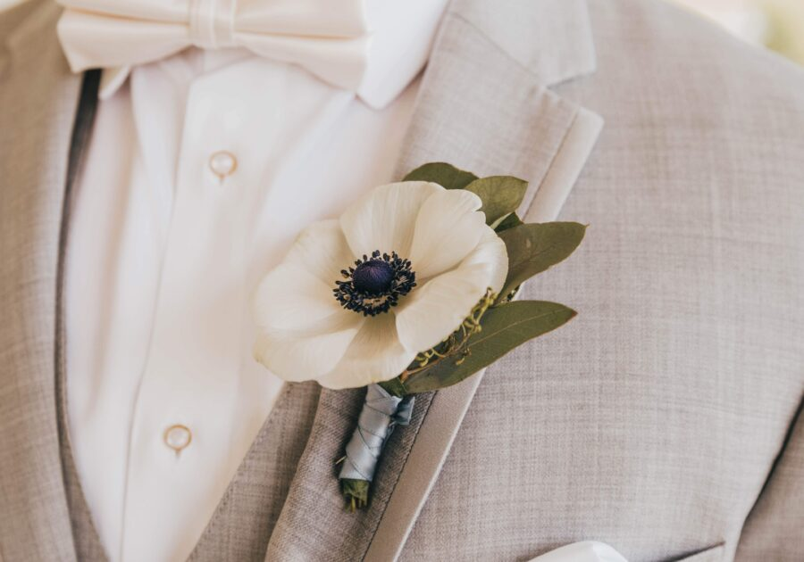 White wedding boutonniere: White Dove Barn Wedding by Grace Upon Grace Photography featured on Nashville Bride Guide