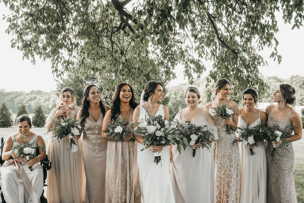 bridal party portrait in mismatched neutral bridesmaid dresses