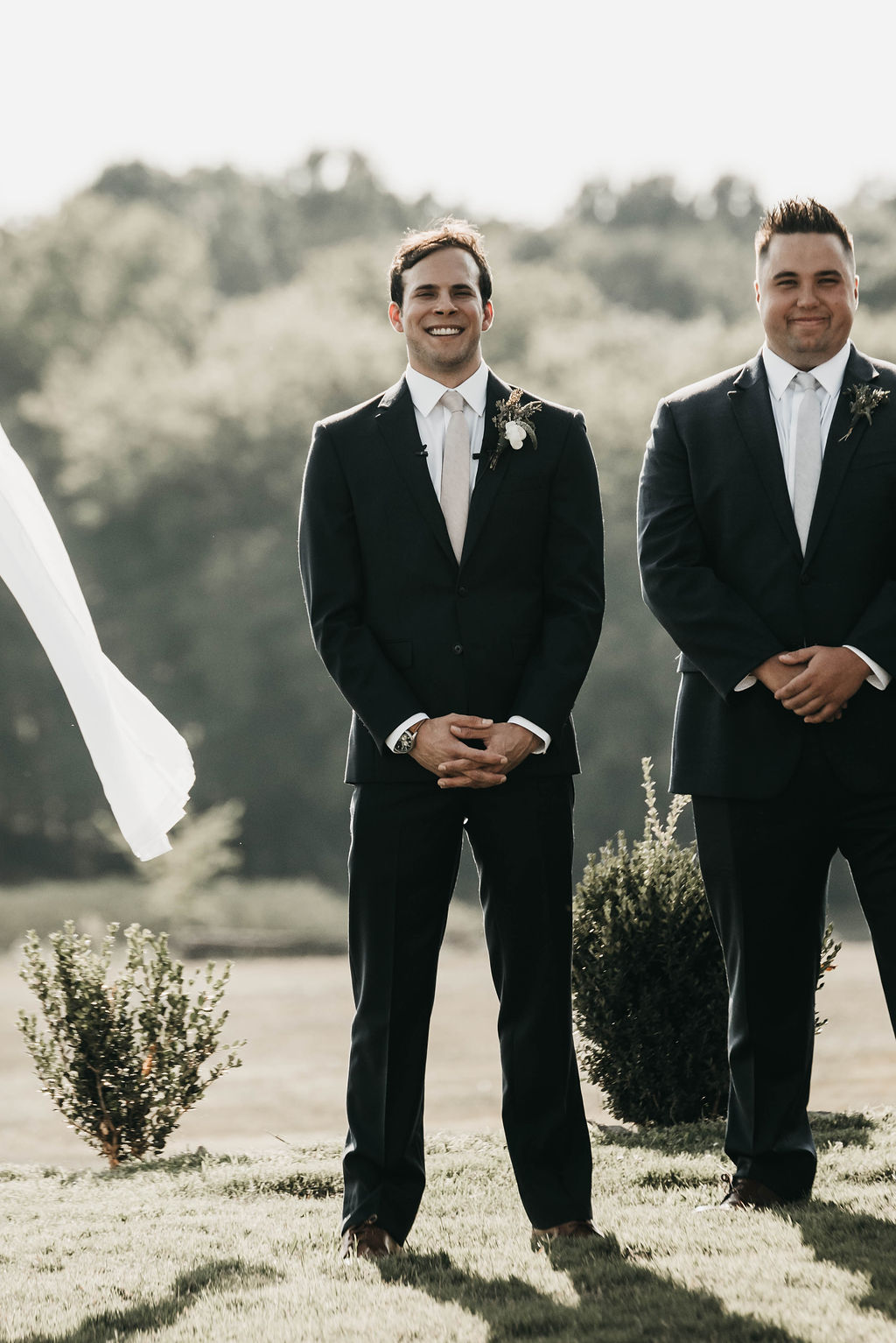 Groom's reaction to seeing bride walk down the aisle
