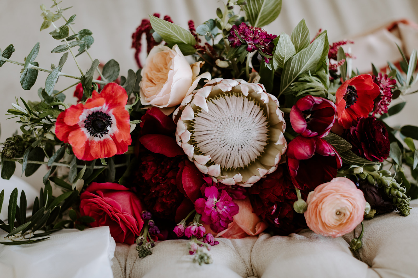 Bright and bold protea wedding bouquet