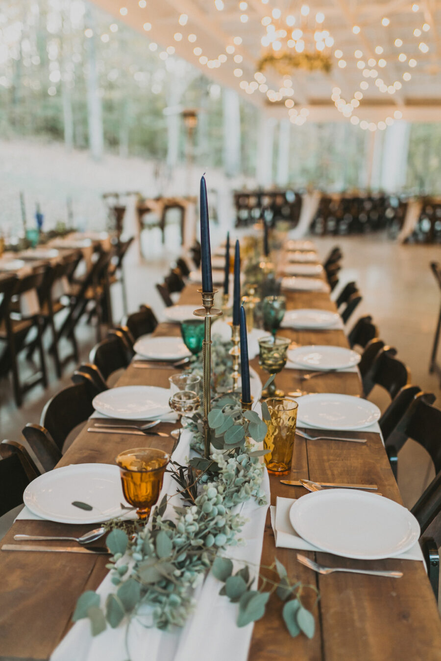 Family style wedding table with greenery