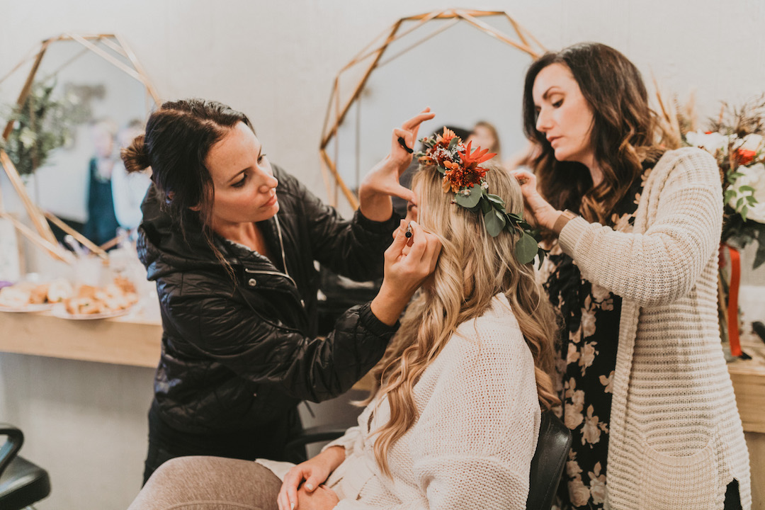 Bride getting wedding hair and makeup done