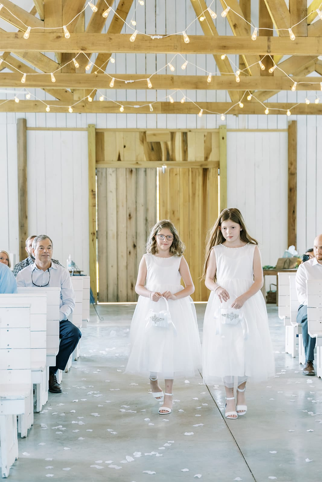 Flower girls walking down the aisle at Grace Valley Farm | Nashville Bride Guide