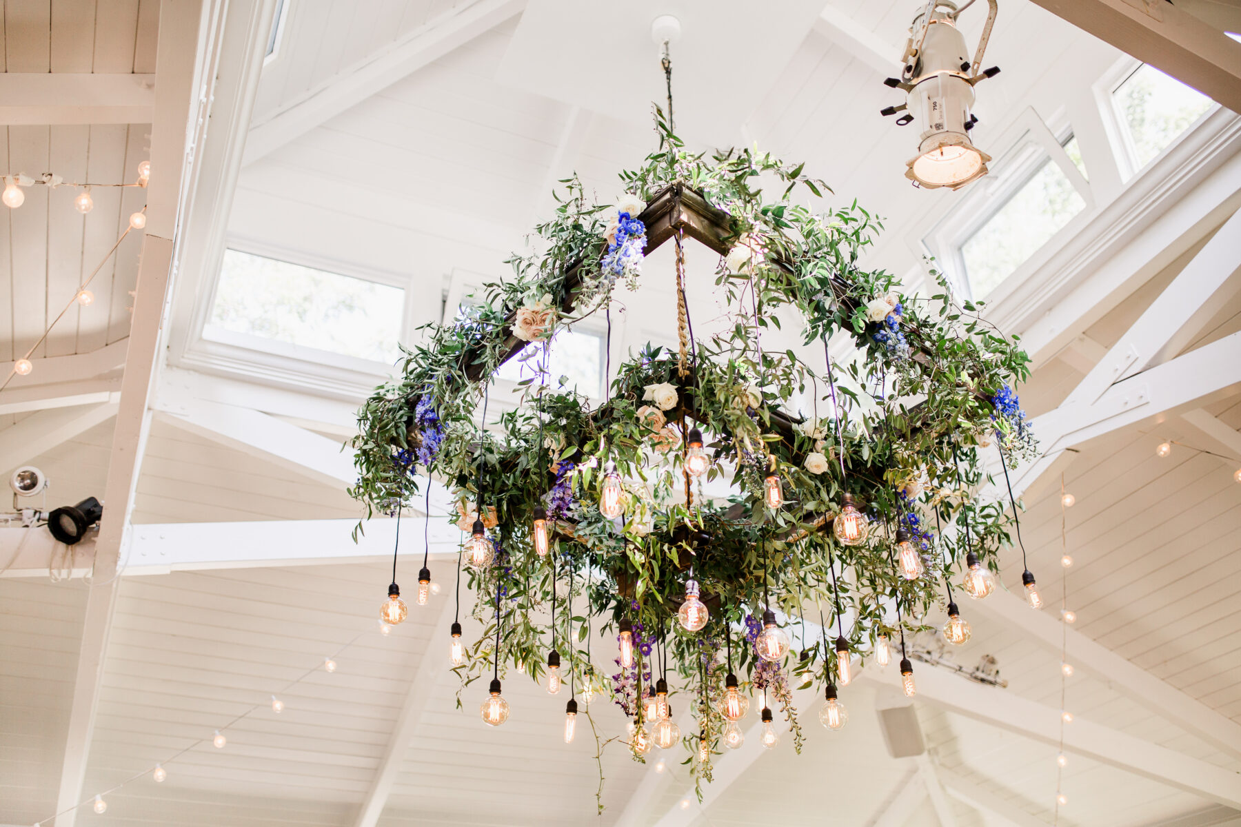 Hanging floral chandelier with Edison bulbs | Nashville Bride Guide