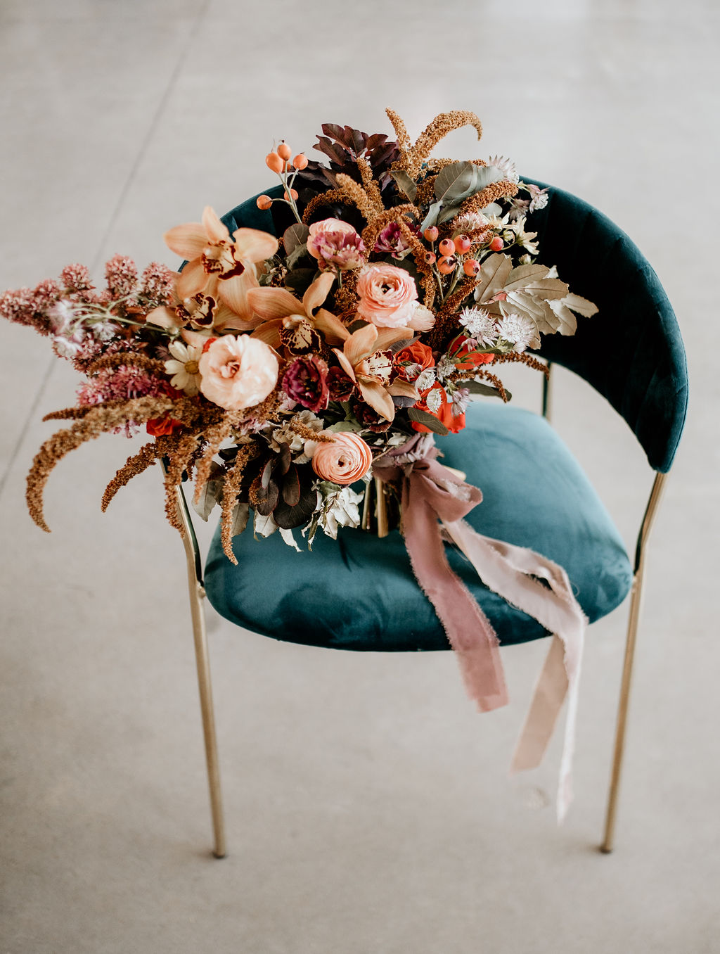 Large colorful wedding bouquet on velvet chair