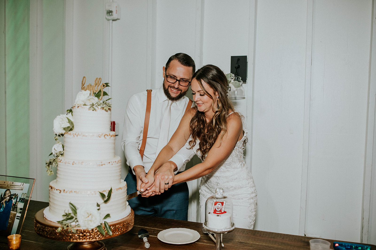 Bride and Groom cutting wedding cake by Copper Whisk Cakes | Nashville Bride Guide