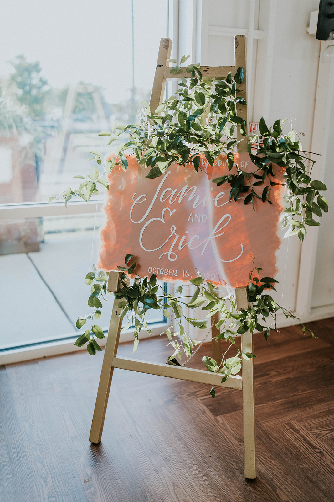 Pink and white acrylic wedding sign with greenery | Nashville Bride Guide