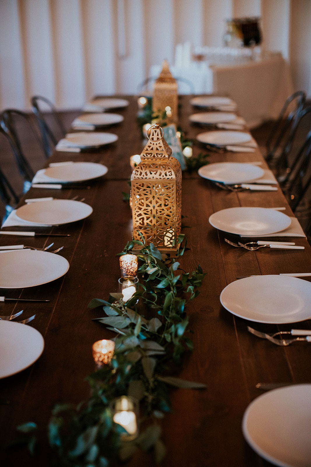 Wood family style wedding tables with lanterns | Nashville Bride Guide