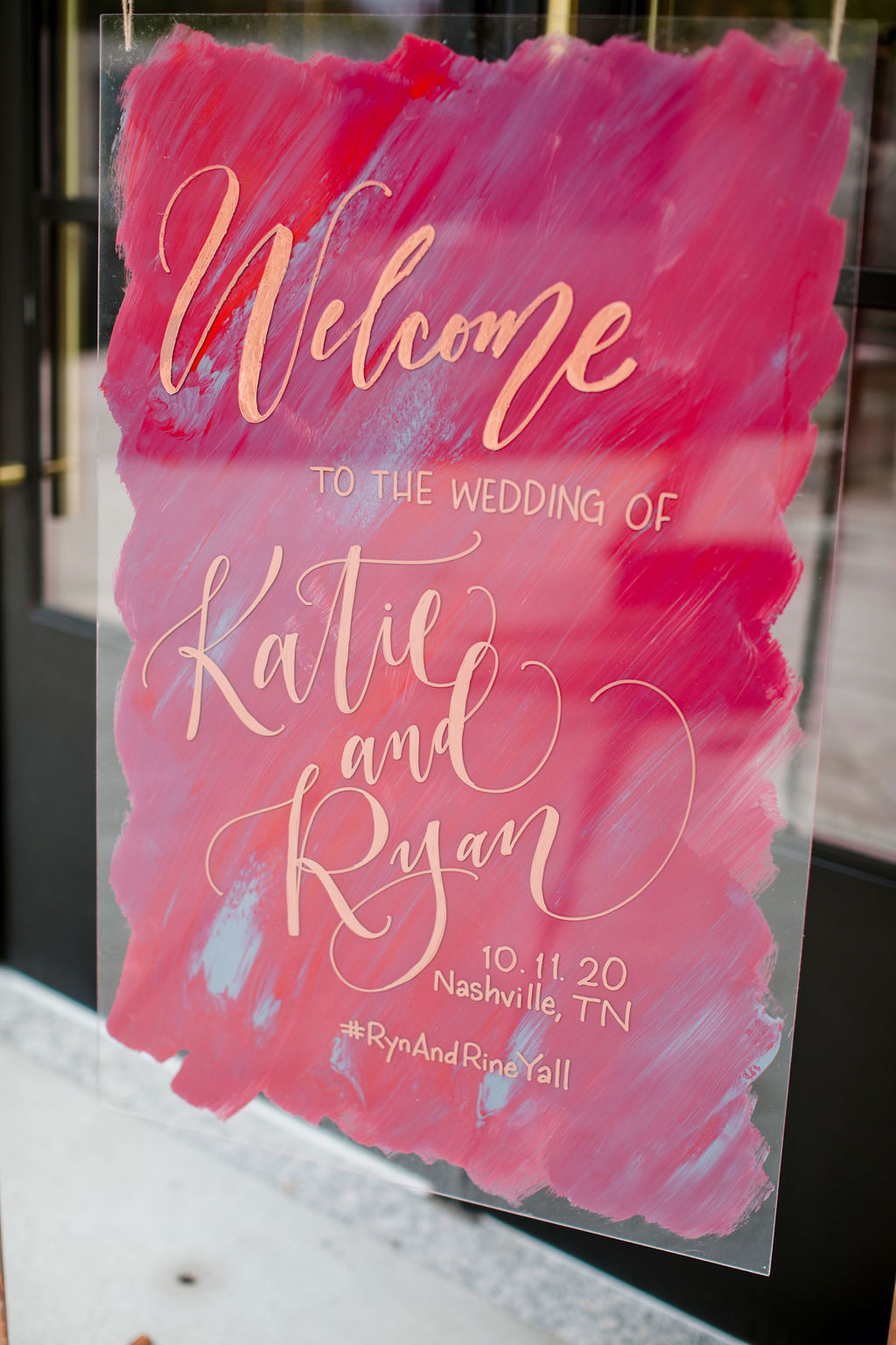 Red and gold acrylic wedding sign | Nashville Bride Guide